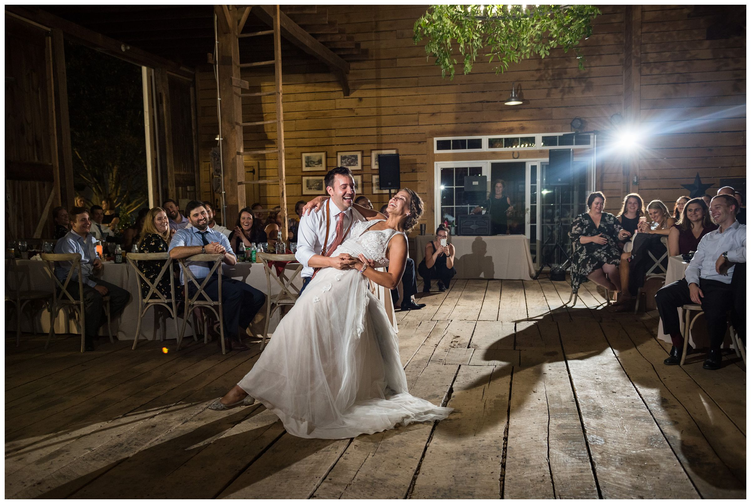 bride and groom sharing their first dance during rustic barn wedding at family farm in Lancaster Ohio