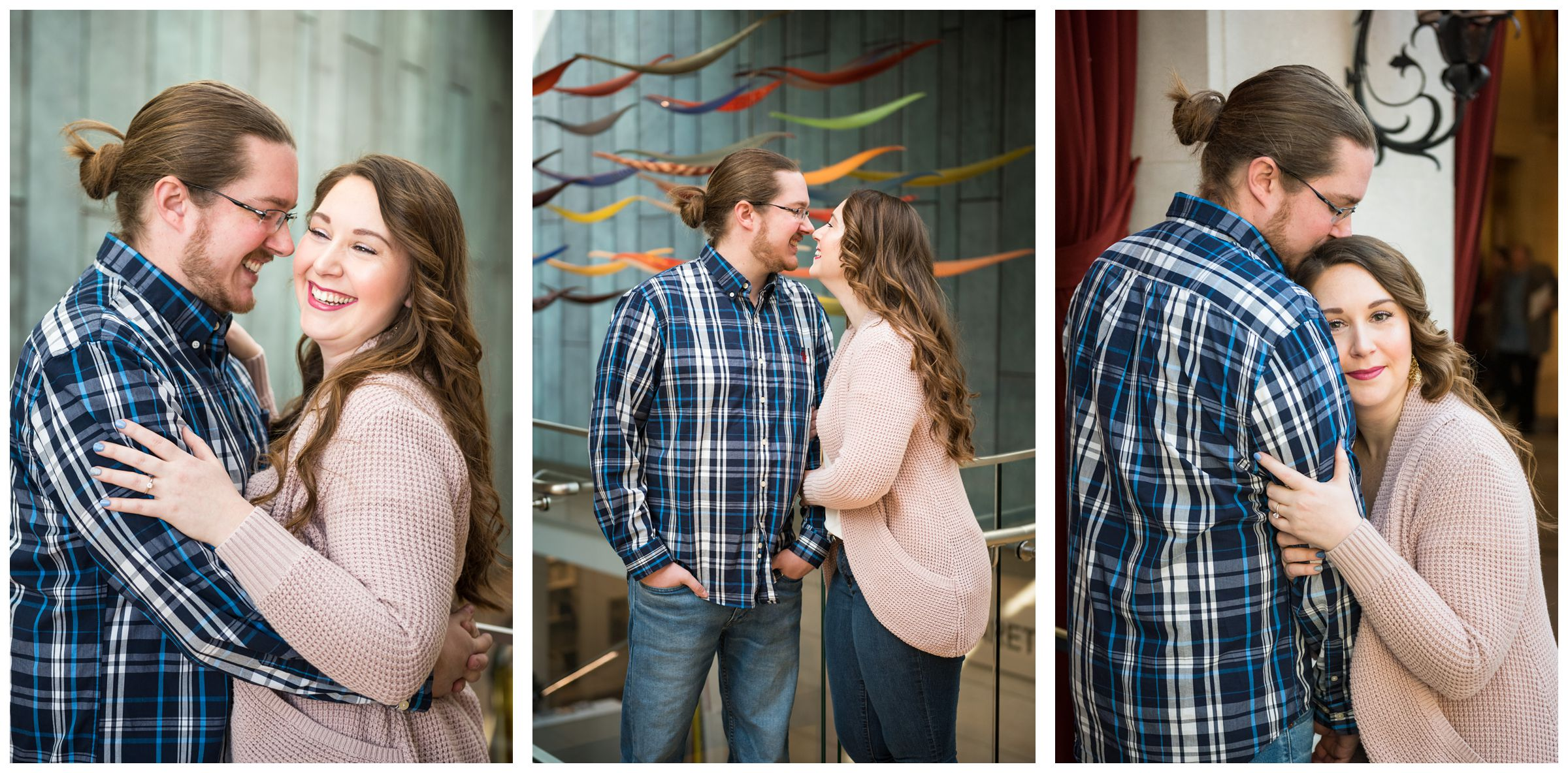 Winter indoor engagement session in the atrium of the Columbus Museum of Art surrounded by colorful hanging glass artwork.