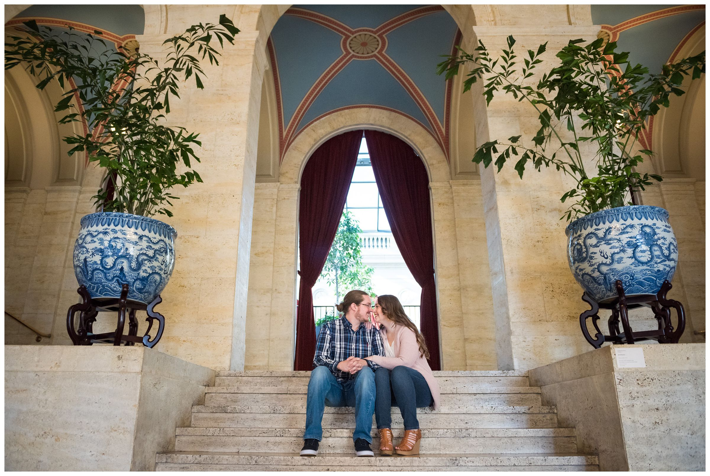 Couple snuggling during Columbus Museum of Art engagement session by Ohio wedding photographer