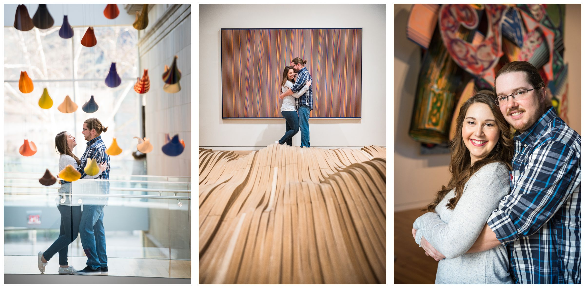 Couple standing near colorful artwork during an indoor winter engagement session at the Columbus Museum of Art